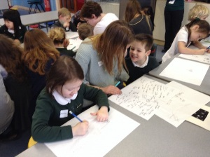 EAC student & pupils planning and drawing superheroes