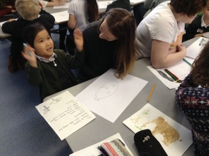 EAC student & pupil planning how to draw a superhero
