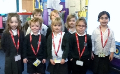Eight pupils proudly displaying their reading riot lanyards