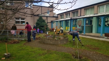 Parent and pupil volunteers working in the central garden.