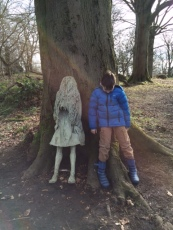 Pupil leaning against a tree mimicing a sculpture of a girl