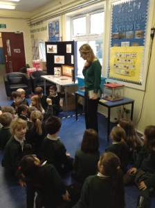 Class Teacher and pupils viewing and discussing the Living Eggs.