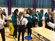 Pupils mingling, asking questions and writimg down the answers