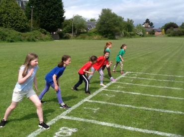 Female pupils getting ready to sprint