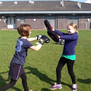 Pupils performing martial arts moves