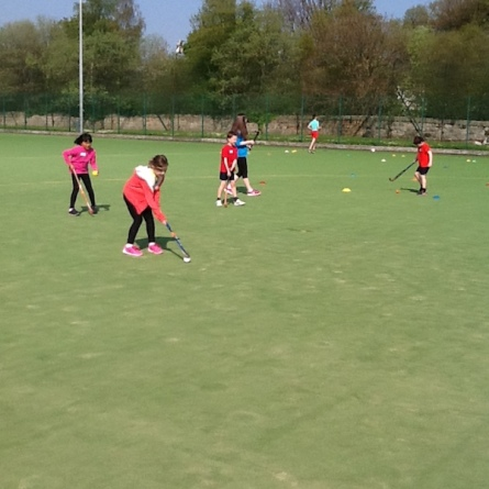 pupils learning hockey skills