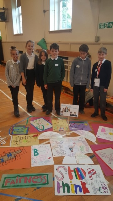 Wardie's Children's Parliament group in front of their wonderful work.