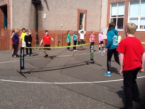 Pupils playing tennis.