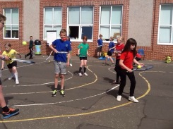 Pupils playing tennis keepie uppie