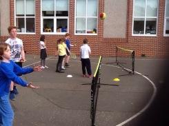 Pupils practising tennis skills