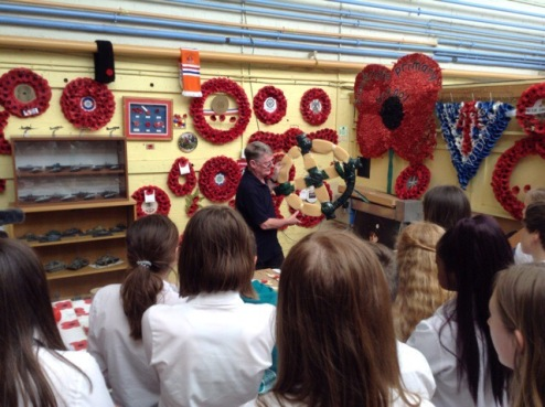 Pupils looking at a poppy display