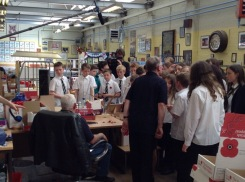 Pupils watching poppies being hand made