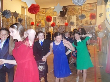 Pupils dancing the Gay Gordons