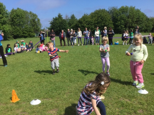 Nursery Children in egg and spoon race.