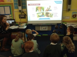 Pupils watching MoneySense digital presentation