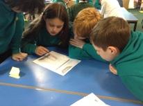 Pupils working on their MoneySense task