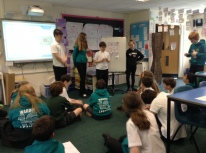 Pupils presenting the results from their MoneySense challenge.